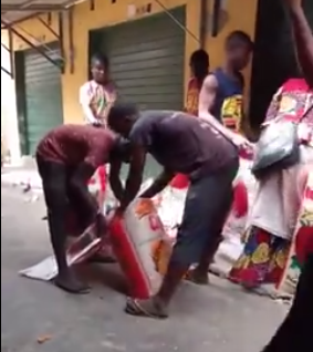 Rice sellers caught on camera removing portions of rice from bags and repackaging to sell as a full bag
