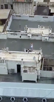 Naked couple caught having sex on rooftop