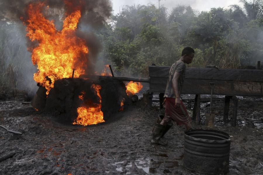 Worker at an illegal refinery in South-South Nigeria