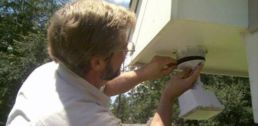 Installing a motion sensor outdoor security light.