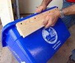 Homemade recycling bin wall cleat on bin