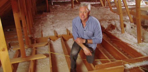 Danny Lipford in an uninsulated attic over a garage. & Does Insulating Over a Garage Save Energy? | Todayu0027s Homeowner
