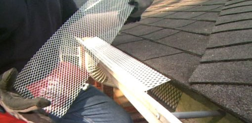 Choosing gutter guard covers for your home todays homeowner installing gutter guard covers solutioingenieria Images