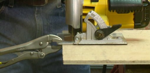 Ripping plywood using locking pliers clamped to circular saw.