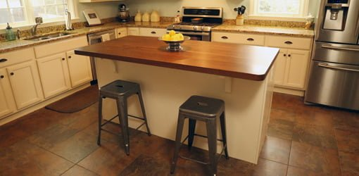 adding a kitchen island to improve efficiency and storage | today's