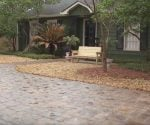 Concrete and masonry sealer on paver driveway.
