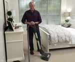 Danny Lipford in bedroom with central vacuum system.