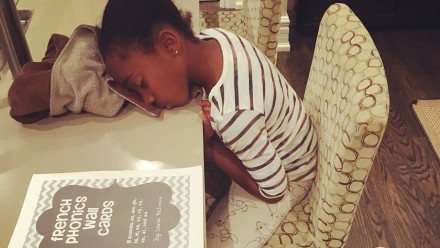 Tracy Moore's daughter with sitting at her desk, face down on her blanket