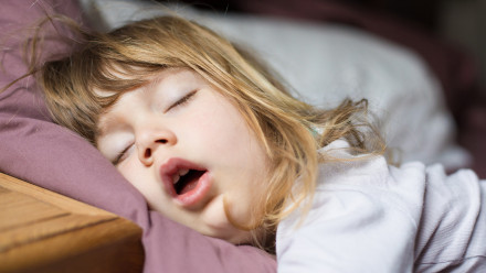 Little girl sleeping with her mouth wide open