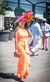 Megan Whitlock, from Dallas, pops in the paddock in striking hot pink and orange.