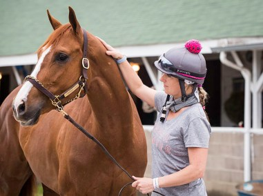 """Exercise rider and local Pilates instructor, Jo Trout, with Purrfect Love. """"My favorite horse just got claimed by another owner, so it's been a rough week."""""""