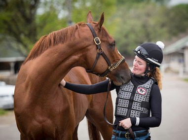 """""""When I first started trying to gallop last year, it was hard because no one wanted to give me a chance. But now, since I'm good, people are watching and are complimenting me and are a lot more open,"""" says Kylie Wellington, exercise rider for Wayne Lucas and an aspiring jockey who hopes to get some races in the fall."""