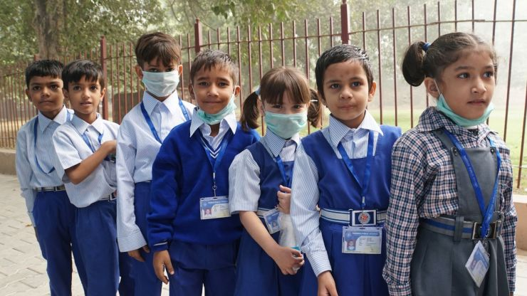 school kids some wearing masks