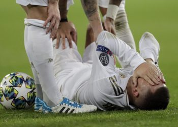 Real Madrid's Eden Hazard reacts injured at the ground during a Champions League soccer match Group A between Real Madrid and Paris Saint Germain at the Santiago Bernabeu stadium in Madrid, Spain, Tuesday, Nov. 26, 2019. (AP Photo/Bernat Armangue)