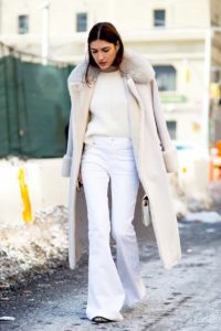 Le-Fashion-Blog-Street-Style-Fashion-Week-Neutrals-Long-Shearling-Coat-Ribbed-Sweater-White-Flared-Jeans-Via-Harpers-Bazaar-1