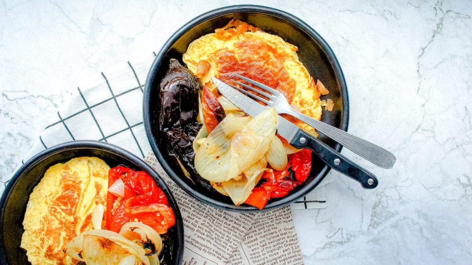 Close up of omelette, and catalan escalivada recipe