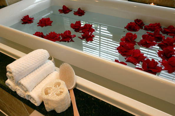 "WASHINGTON - JANUARY 5: Rose props float in a bath tub in the Presidential Suite at the Mandarin Oriental Hotel during a press preview of the hotel's ""Presidential Privilege 2005 Inauguration Package"" January 5, 2005 in Washington, DC. The $200,500 package features a five-day, four-night stay in the 3,500-square foot Presidential Suite, private jet service to and from Washington, 24-hour personal butler service, designer inaugural ball fashions, tickets to an inaugural event, a personal chauffer-driven Maybach for the entire stay and a U.S. flag which had flown over the U.S. Capitol as a commemorative gift. (Photo by Alex Wong/Getty Images)"