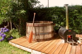 bain-norqieu-eau-chauffer-poele-autonomie-détente-maison-bois