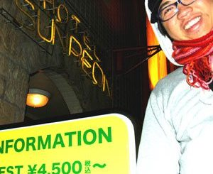 Jong Pairez in front of a Shibuya love hotel