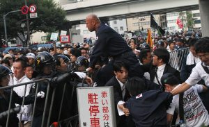 Right-wing groups clash with police during a rally opposing Yasukuni Shrine