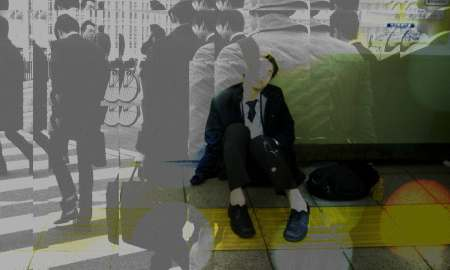Exhausted Salaryman sleeps on a train platform