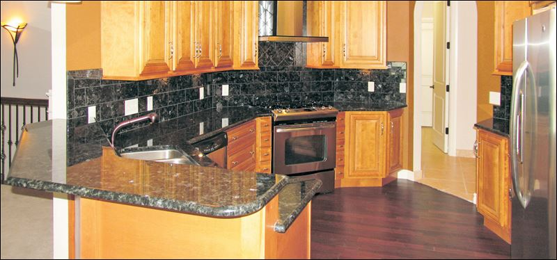 Exquisitely Finished: Home Features Marble, Granite And ... on Maple Kitchen Cabinets With Black Granite Countertops  id=50270