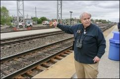 Tony Phillips points to the condo in Chicago where he lives on the other side of the tracks at the Halsted Station, where oil trains pass by.