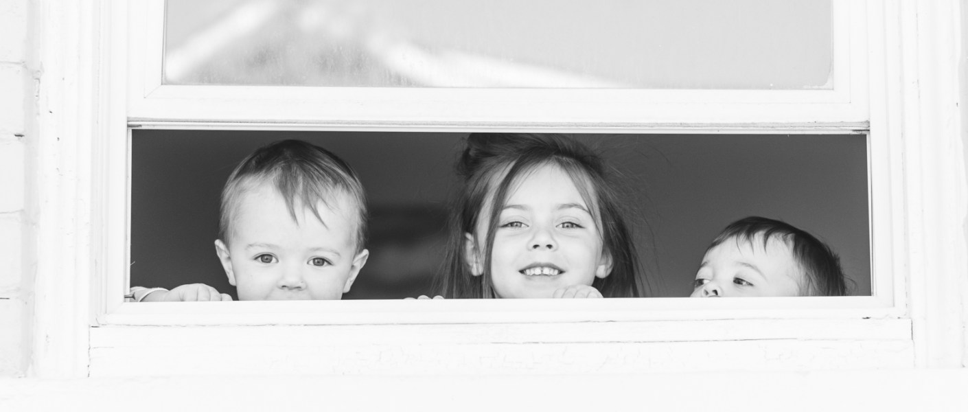 3 kids at the window