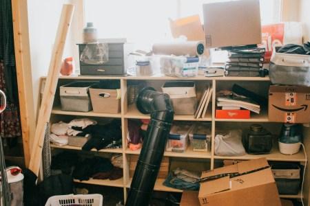 cluttered master closet