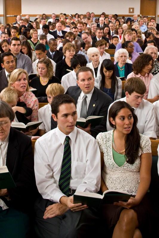 church congregation singing a hymn