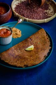 mapillai samba adai served on a turquoise blue plate against a blue backdrop