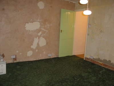 pic of bedroom with horrid bare plastered walls