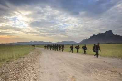 Soldiers marching across terrain