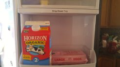 With the drop down shelf in the up position,, we can now fit milk in the shelf below.
