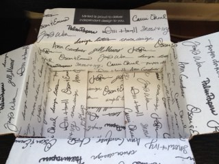 The fancy box with signatures of designers that my ordered arrived in.