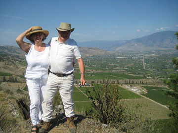 Elaine & Don Triggs at the top of their world (see the winery under Don's left hand