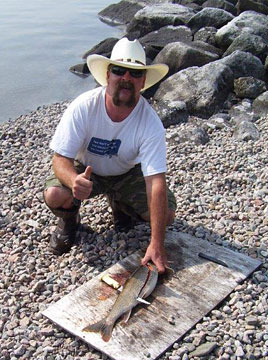 Chad filleting a lake trout for shore lunch