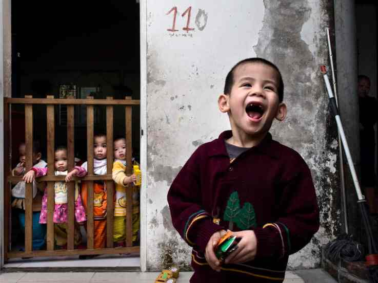Group of children inside a Buddhist orphanage in the outskirts of Hanoi. These are children that were abandoned or left behind because of mental problems or physical disabilities. The Buddhist nuns take very good care of them even if the conditions are quite difficult.