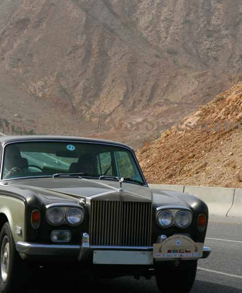 Rolls-Royce driving through Oman's mountains
