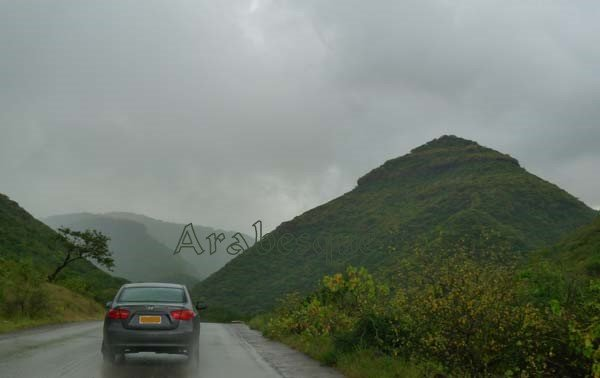 Rain clouds gather over Oman's southern mountains