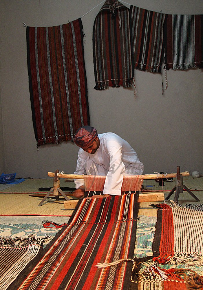 Rug Weaver at work