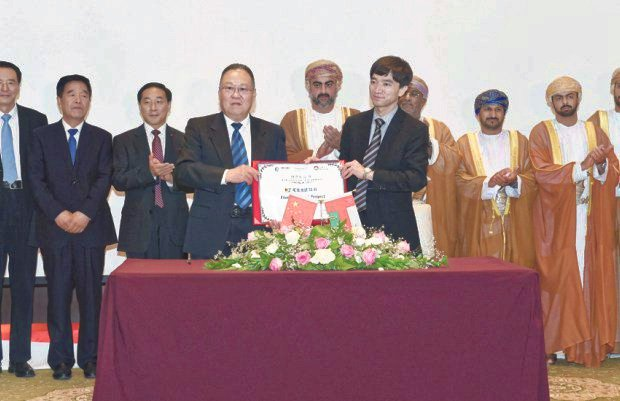 Ali Shah right general manager of China-Arab Wanfang with a sub tenant