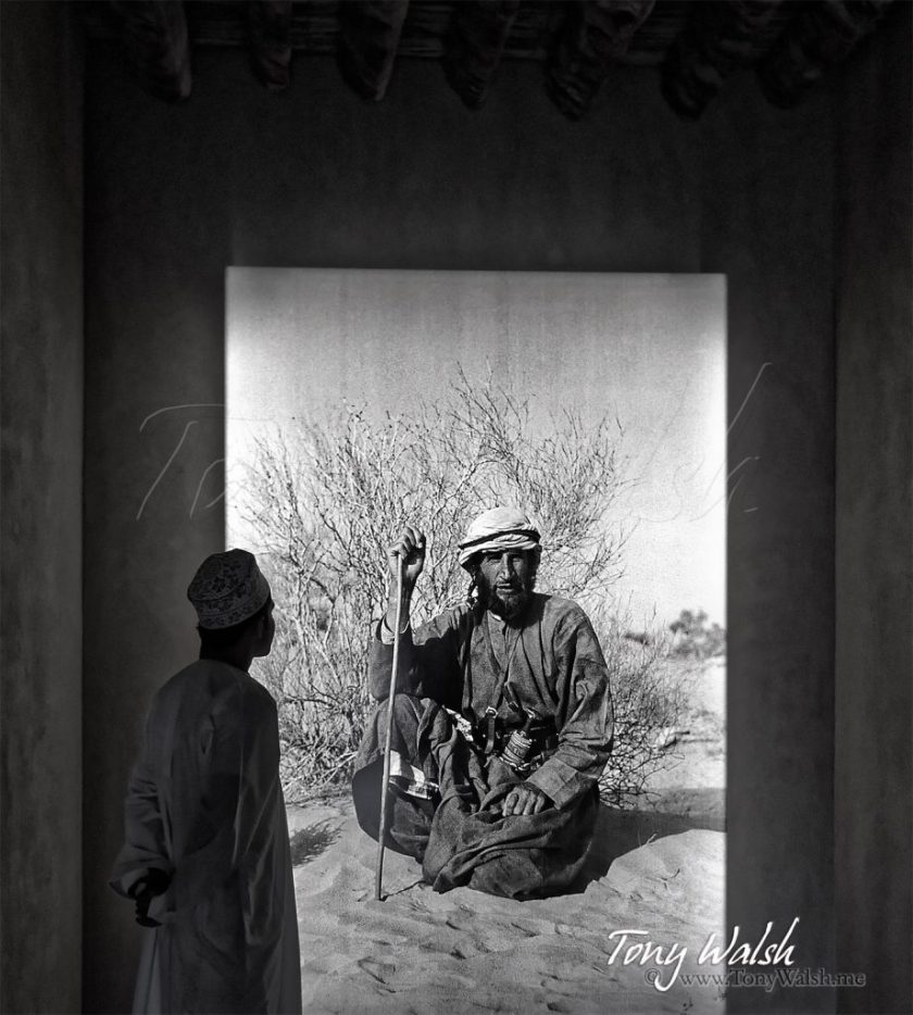 Wilfred Thesiger is looked at by an Omani man