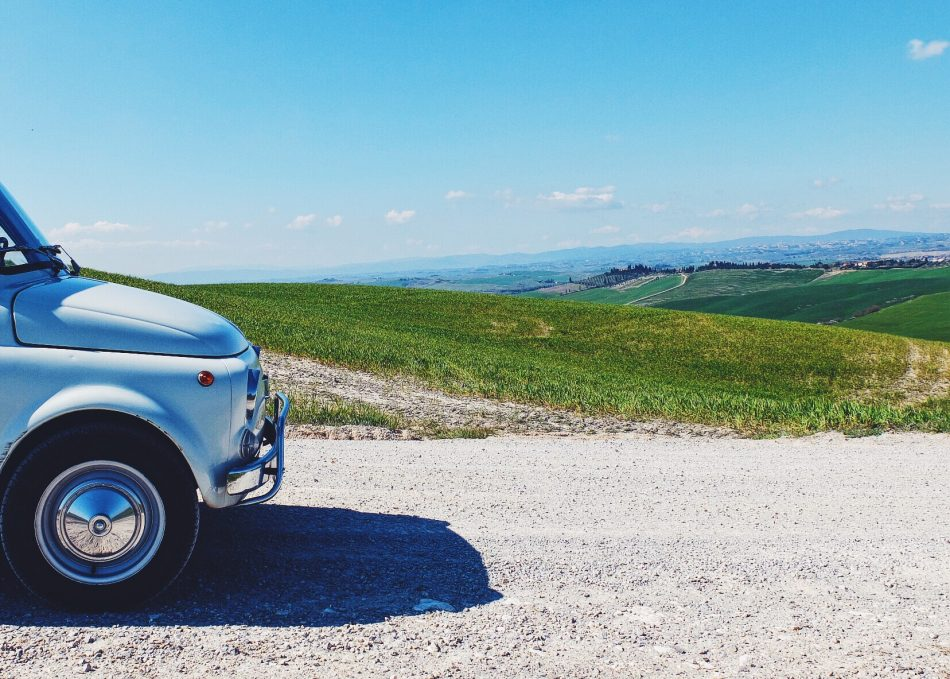 Driving a vintage FIAT 500 car in Valdorcia