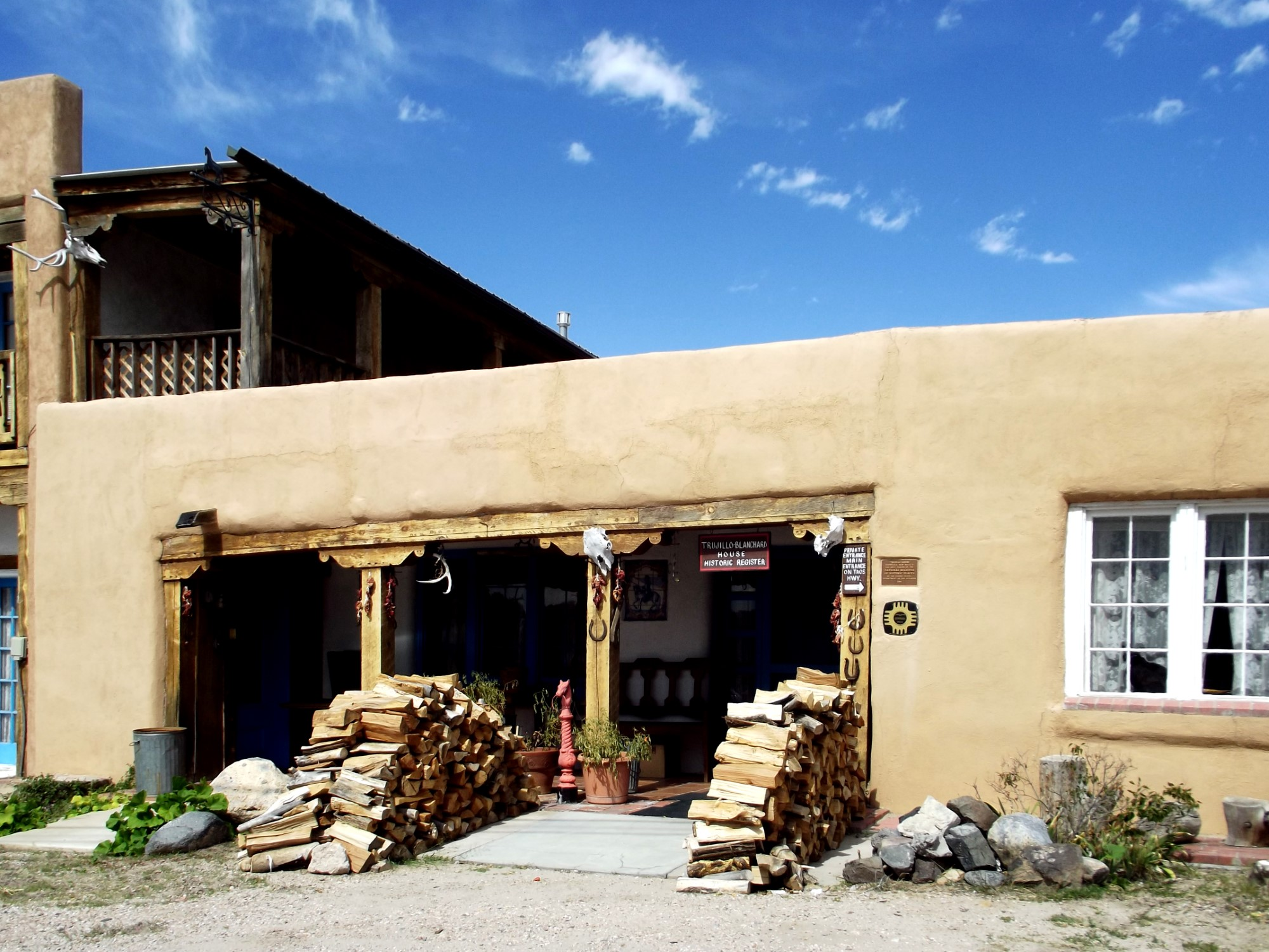 Adobe building with woodpiles