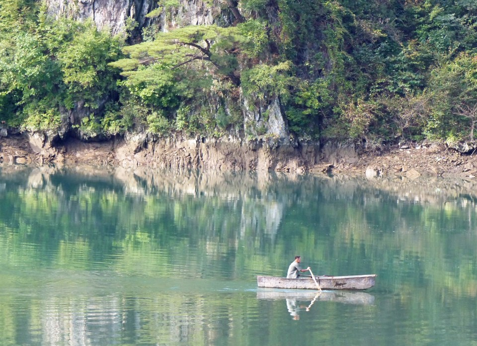 Man rowing a boat on a lake