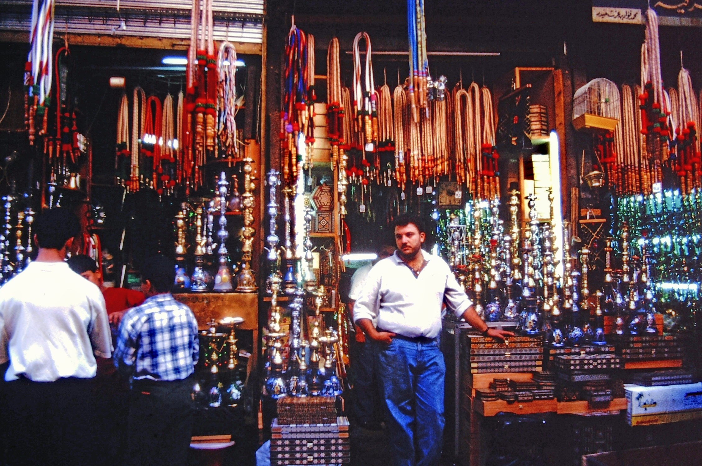 Men outside a shop selling lamps and worry beads