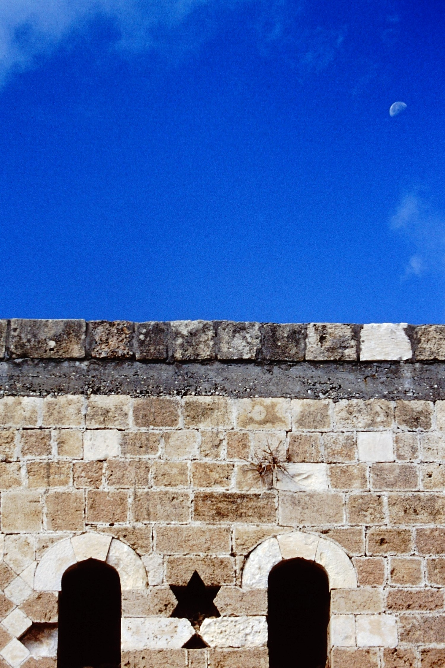 Stone wall and moon in the sky
