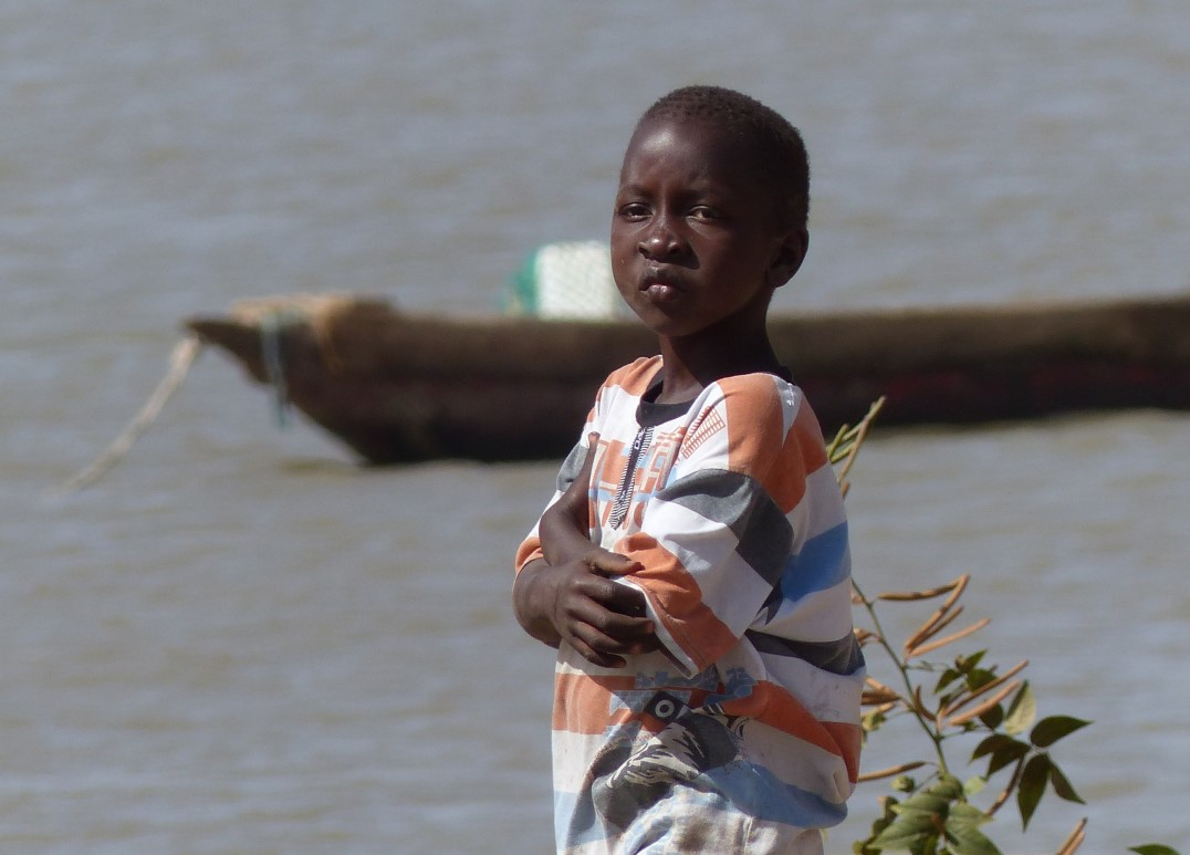 Child with river behind