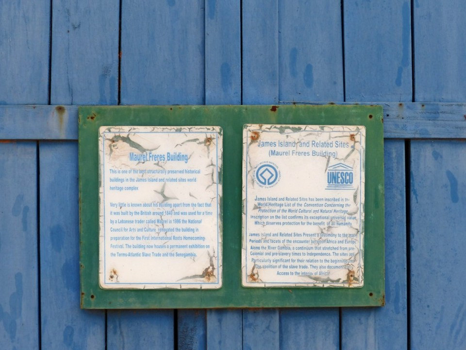 Signs on a blue wooden wall